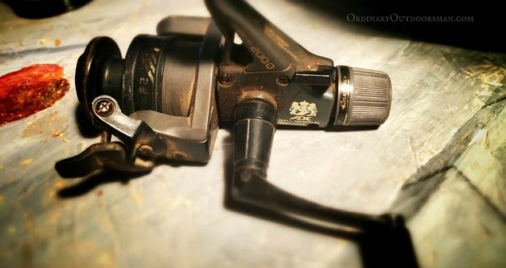photo of an old, dusty fishing reel