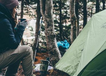 photo of woman and a tent with the caption: 6 reasons to go camping in the spring.